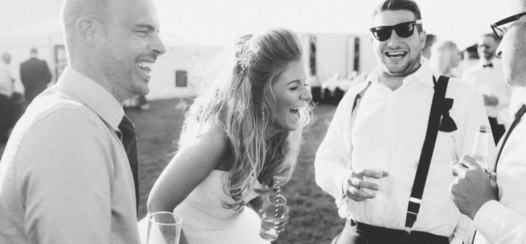 bride laughing black and white summer party