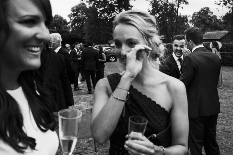 two people crying at a wedding
