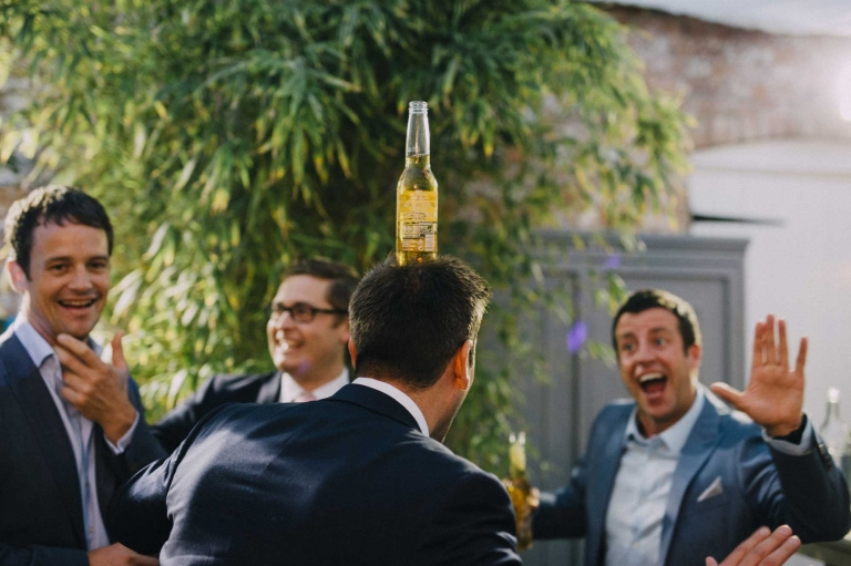 wedding guest balances beer on head